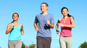 stock-footage-three-fit-young-people-keeping-fit-jogging-together