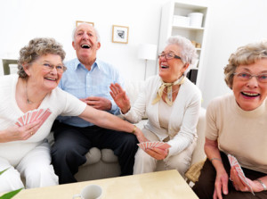 senior-man-and-women-playing-cards-at-home