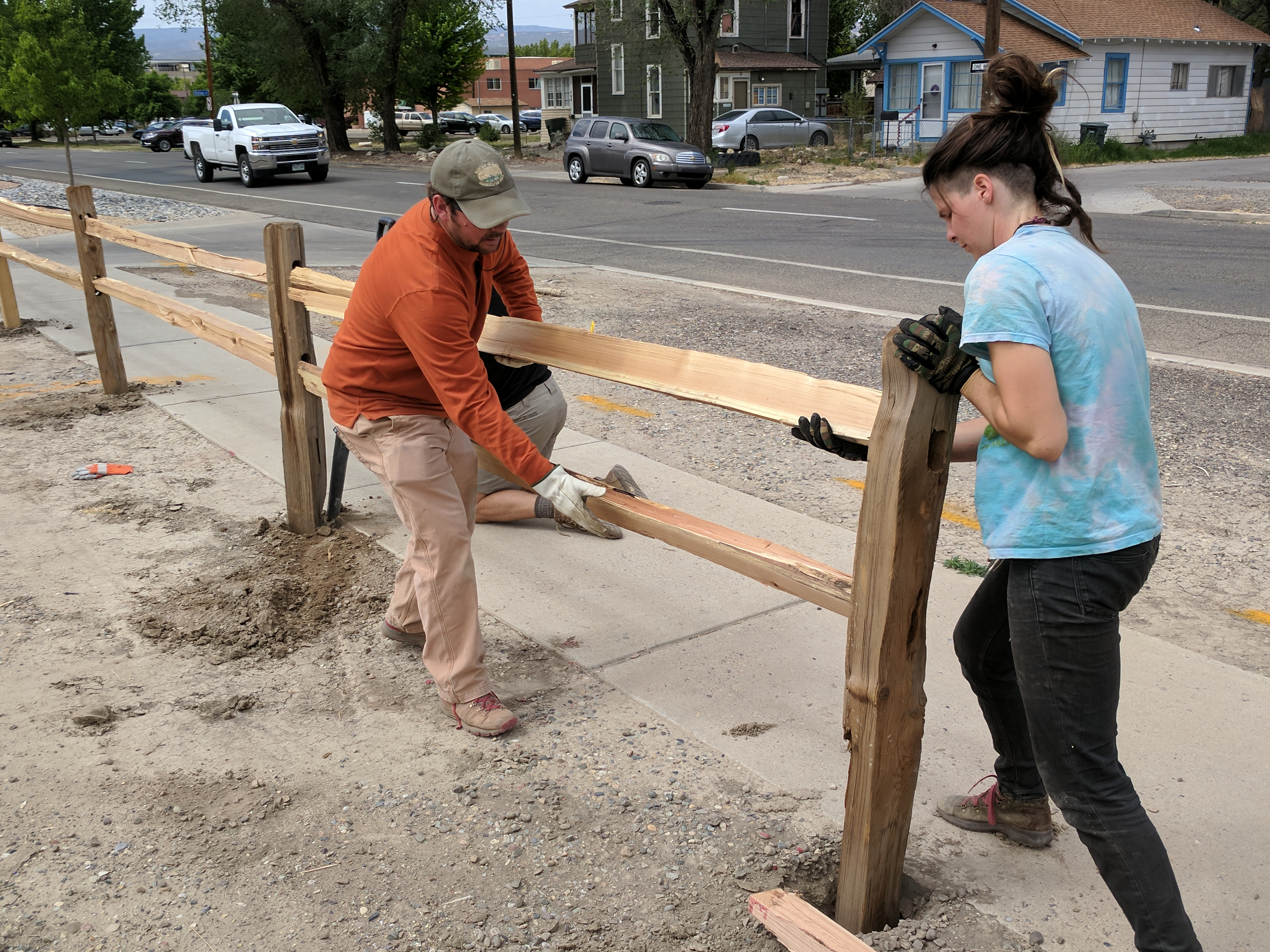 Volunteers work on garden fence
