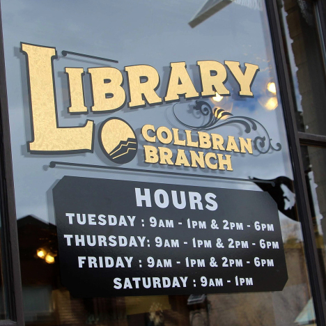 Photo of Collbran Branch Library window sign