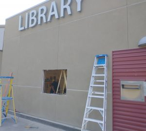 Hole cut in wall of Central Library for installation of drive-through window